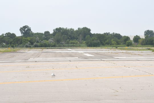This is the shorter second runway at the Coleman A. Young International Airport in Detroit. The report proposes closing this runway and using the land for industrial development.