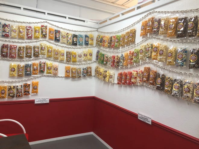 Upon walking into the Faris Gourmet Popcorn retail shop, customers will see a wall of popcorn options in various flavors and colors.