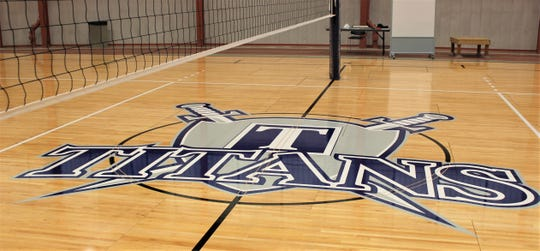The new Terra Titans logo on the volleyball court.