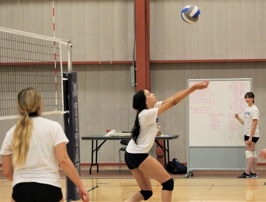 Layla Clingman sets the ball during a recent practice for the Terra State Titan volleyball team.