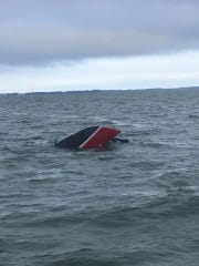 Boat capsized in Lake Erie where man was saved by Fisherman's Wharf boat Sunday night.
