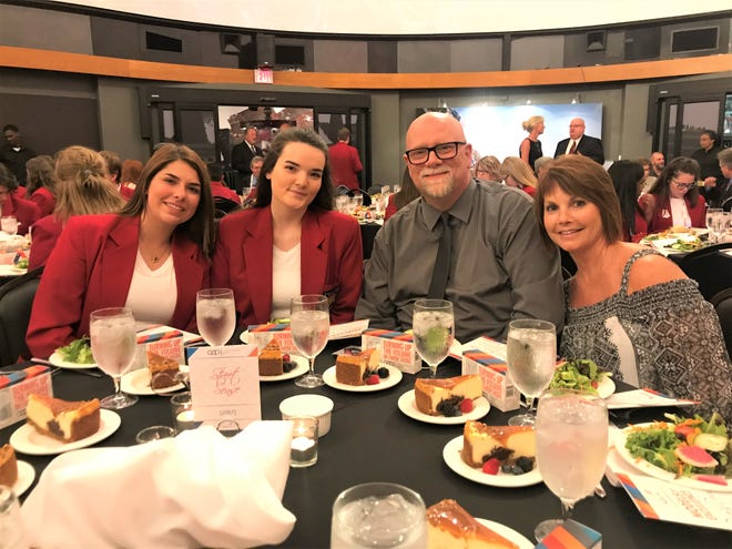 Left to right are students Cami Caudill, and Stormy Vallance, plus Floyd Collins, SkillsUSA Adviser, and Lyne Walby, assistance director. The photo was taken during the recognition event at Kentucky Derby Museum.