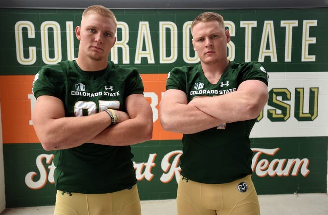 Colorado State football players Trey McBride and Toby McBride stand in Canvas Stadium in Fort Colins for a portrait on Friday, Aug. 16, 2019.