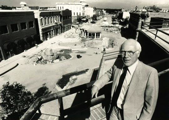Gene Mitchell posing over Old Town Square in 1984.