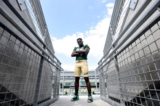 Colorado State football player Joshua Griffin stands over Canvas Field in Fort Collins a portrait on Friday, Aug. 16, 2019.