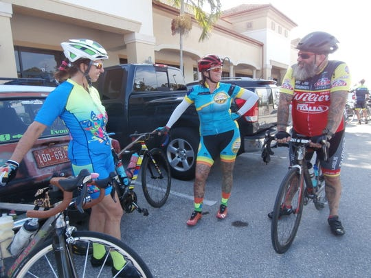 Isobel Hitchcock, center, president of the Caloosa Riders Bicycling Club, is flanked by fellow members Sloane Jackson, left, and Kelly Rogers after a recent Bagel Factory ride.