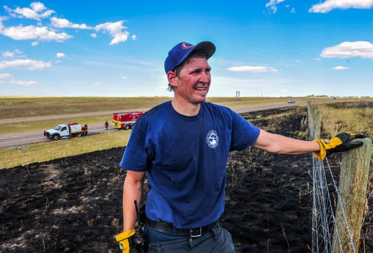 Firefighters with the Montana Air National Guard, including Ben Hilpert, helped put out a fire along Interstate 15 Monday. Hilpert said the fire really picked up when the wind shifted.