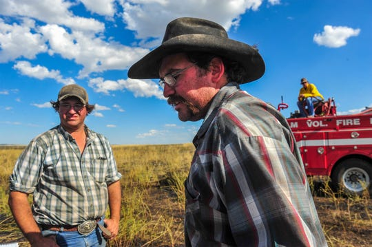 "Andrew Gould owns the land where the largest of four fires burned Monday. ""We're going to lose some pasture for our cows,"" he said."