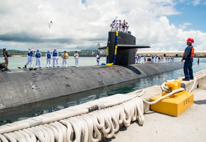 Sailors assigned to the Los Angeles-class fast attack submarine USS Oklahoma City (SSN 723) return from a four month deployment. Oklahoma City is one of four forward-deployed submarines assigned to Commander, Submarine Squadron Fifteen out of Apra Harbor, Guam.
