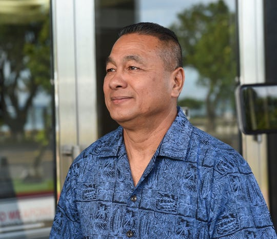 "William Topasna Mantanona walks from the District Court of Guam following his court hearing in Hagåtña, Aug. 19, 2019. Mantanona, and his brother, former Guam Police Department Officer John ""Boom"" Mantanona, were arrested on charges of obstructing justice, according to a news release."