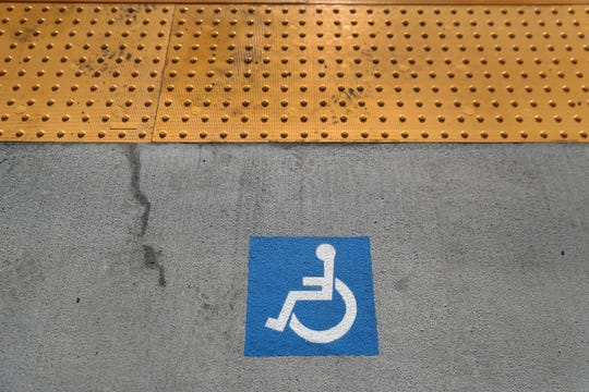 Wheelchair and bike symbols on platforms let passengers know where to board. People in wheelchairs can get on through the front or middle doors.