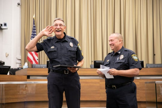 Sgt. Chris Akers retires from the Iowa City Police Department on August 14, 2019, at City Hall.