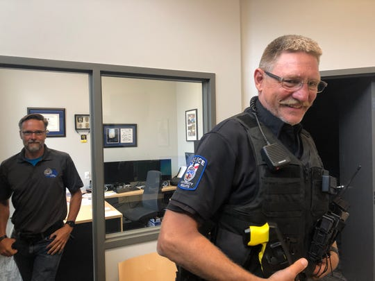 Chief Troy Kelsay (left) and Officer Chris Akers prepare for a day of office work and patrol, respectively, on August 19, 2019, at the University Heights Police Department.