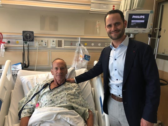 Neurosurgeon Justin Singer and Dan Magennis take a picture together at Spectrum Health, the hospital  in Michigan where Magennis had his procedure to unclog the artery that led to his stroke.
