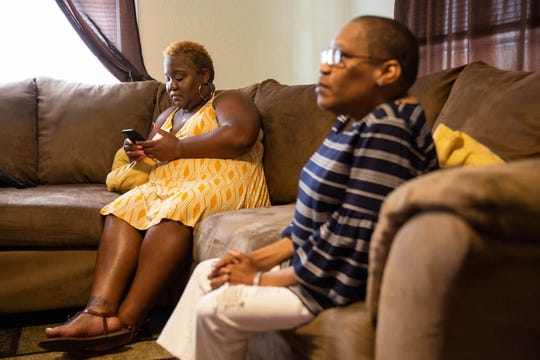 Jaimie Cummings sits with her mother, Sharon, in their new home in New Orleans, where they live with their dog, Princeton. The pair returned to New Orleans 13 years after Katrina forced them to evacuate.