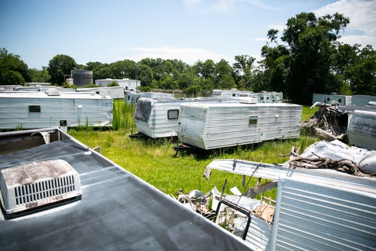 """In Port Barre, Louisiana, residents complain about """"abandoned"""" FEMA trailers that have been sitting off a busy highway for years. FEMA says the trailers don't belong to the agency, but after use in disasters, many trailers are auctioned off by the General Services Administration. Private buyers can bid on the units online, which could explain this eyesore in Port Barre."""