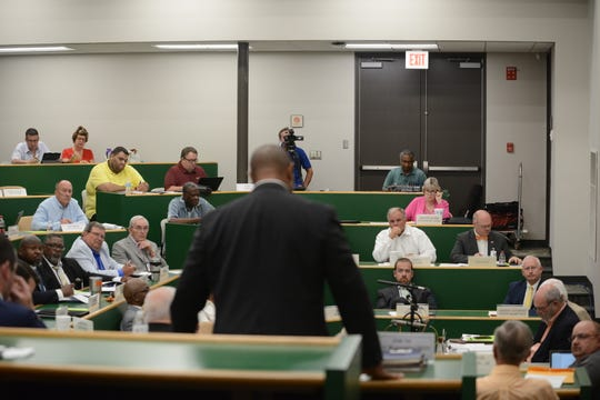 JMCSS Superintendent Ray Washington, center, addresses the Madison County Commission during its Aug. 19 meeting.