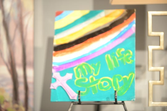 A child who gets services at the Exchange Club- Carl Perkins Center for the Prevention of Child Abuse painted a rainbow with colors to represent what she's experienced. The painting inspired the Circles of Hope theme, 'Our Colors, Our Story, Our Journey.'