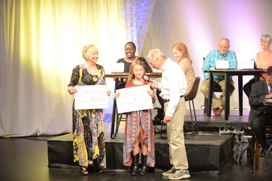Martha Shaeffer and London Arwood present checks from fundraisers done in Fayette Co.