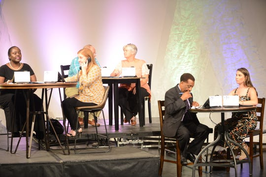 One group of volunteer phone operations take calls and donations during the televised and live streamed Circles of Hope Telethon, which raised $1.4 million for the Exchange Club- Carl Perkins Center for the Prevention of Child Abuse.