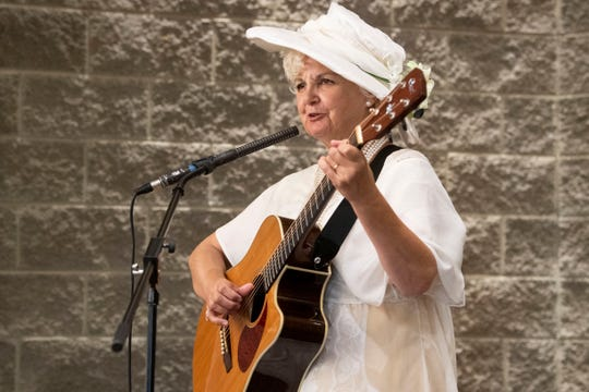 "Candace Corrigan performs a song from the play, ""A Vote of Her Own"" at the Suffrage Coalition's Febb Burn Day Dinner and Suffrage Sampler at The Foundry on Sunday, August 18, 2019."