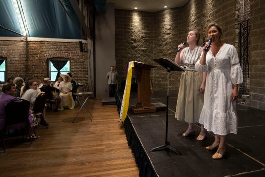 "Katy Wolfe, right, and Hannah Jones of the River & Rail Theatre, perform a song from ""The Burn Vote,"" a musical in production by River & Rail about state legislator Harry T. Burn's significant contribution to Women's Suffrage. The song was performed on Sunday, August 18, 2019 at the Suffrage Coalition's Febb Burn Day Dinner and Suffrage Sampler at The Foundry."