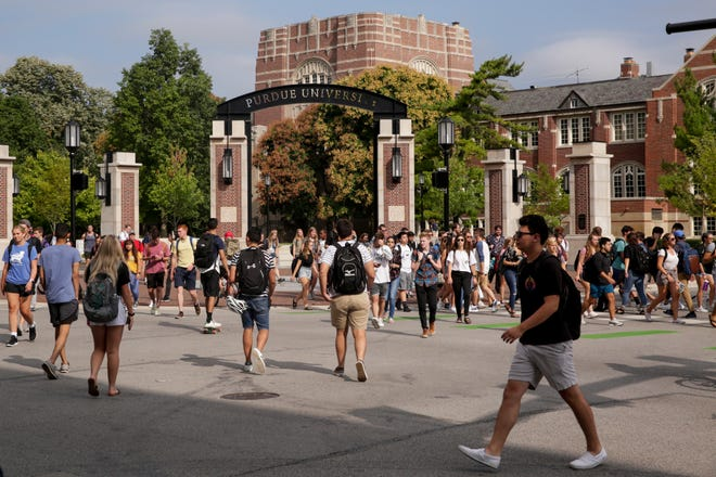 Students cross the State and Grant streets intersection during the first day of classes, Monday, Aug. 19, 2019 at Purdue University in West Lafayette.