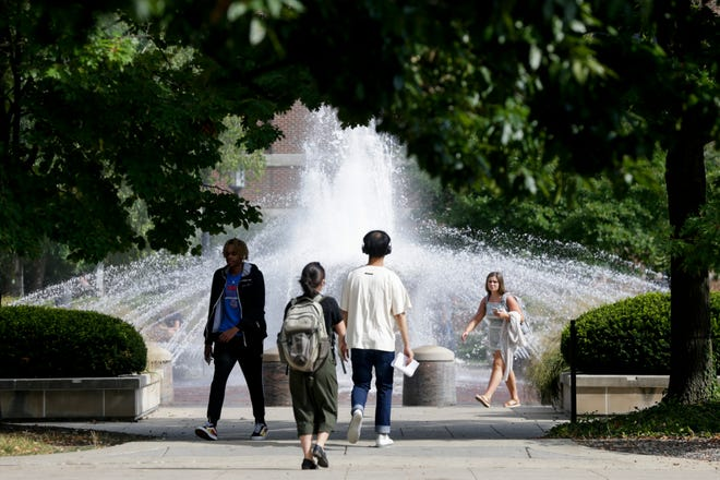 Students walk by the Loeb fountain during the first day of classes, Monday, Aug. 19, 2019 at Purdue University in West Lafayette.
