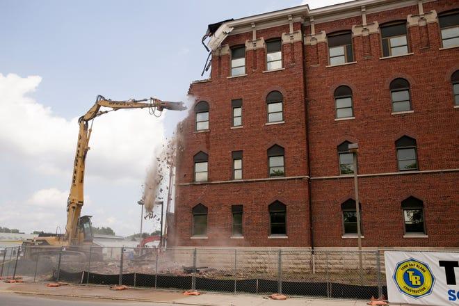 Demolition begins on the Old St. Elizabeth's building on N 14th st., Monday, Aug. 19, 2019 in Lafayette.