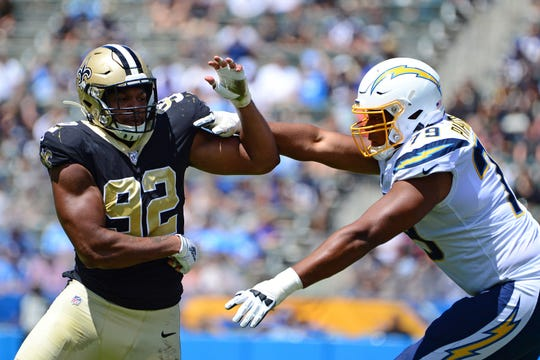 Aug 18, 2019; Carson, CA, USA; New Orleans Saints defensive end Marcus Davenport (92) works against Los Angeles Chargers offensive tackle Trey Pipkins (79) during the second quarter at Dignity Health Sports Park. Mandatory Credit: Jake Roth-USA TODAY Sports