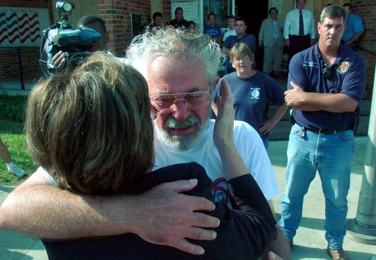 Town council member, John LeBlanc, center, gets a pat on the check from Louisiana Gov. Kathleen Blanco, left, Friday Sept. 30, 2005, after she arrived in Erath La. one of the hardest hit areas by Hurricane Rita. Erath Fire Chief Wane Mouton , right, looks on.Photo by Brad Kemp