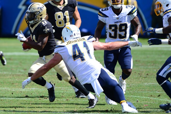 Aug 18, 2019; Carson, CA, USA; New Orleans Saints wide receiver Deonte Harris (11) is defended by Los Angeles Chargers defensive back Rodney Randle (41) during the third quarter at Dignity Health Sports Park. Mandatory Credit: Jake Roth-USA TODAY Sports