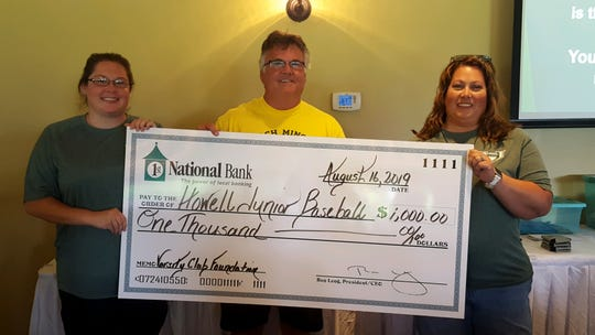 Retired coach Jeff Minock awards $1,000 to Howell Junior Baseball Association board members Amandra Banda (left) and Stacey Steakley (right) at a charity golf outing at Chemung Hills Golf & Banquet Center, Friday, Aug. 16, 2019.