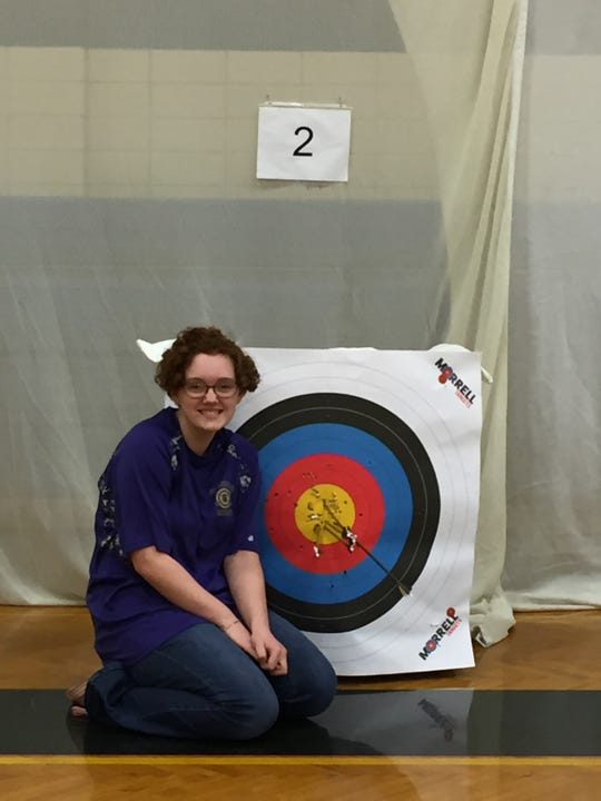 Anna Herbert of Fowlerville scored a perfect 300 in an archery competition in Portage in January and was the national high school champion.