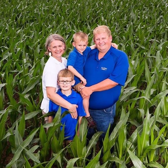Ryan Bivens is a soybean, corn and wheat producer from Hodgenville. He's pictured here with his family.