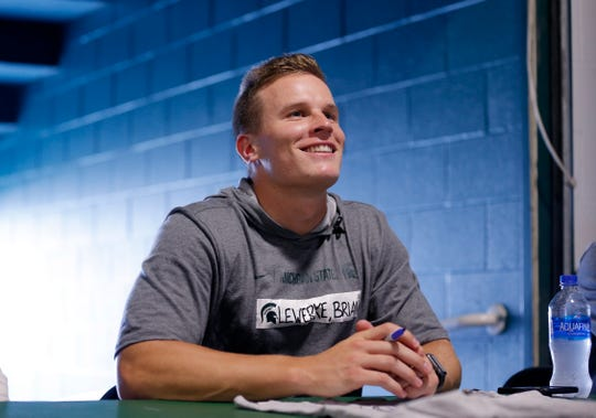Brian Lewerke greets fans during the Meet the Spartans event Monday.