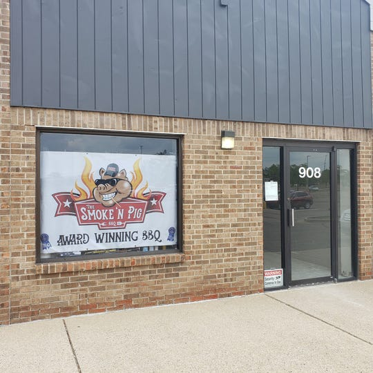 The future home of Smoke 'N Pig BBQ's new restaurant, situated in a plaza off Elmwood Road just across from the Lansing Mall in Delta Township already sports the eatery's logo in a window.