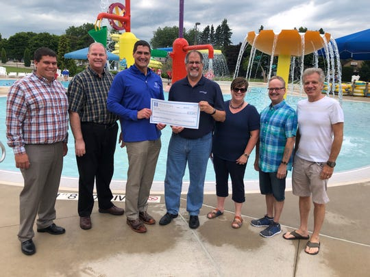 Investors Community Bank has given $25,000 to phase 3 of the Manitowoc Family Aquatic Center's capital campaign. Pictured from left: Bryan Orth, Friends ofManitowoc Aquatic Center Board member;Jeff Jagodinsky, Friends of Manitowoc Aquatic Center Board member;Tim Schneider, Investors Community Bank CEO and co-founder;Chuck Krueger, Friends of Manitowoc Aquatic Center Board member;Amy Fricke Weigel, Friends of Manitowoc Aquatic Center Board member; Allan Brixius, Friends of Manitowoc Aquatic Center Board member; and Jay Muchin, Friends of Manitowoc Aquatic Center Board member.