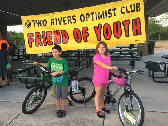 Winners of bicycles donated by Thrivent Financial were Jordan Ostrom (left) and Aria Panosh at the 2019 Two Rivers Bike Rodeo.