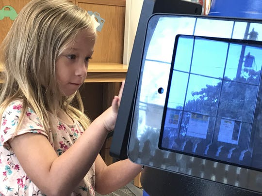 Leta Keller enjoys playing a game on the Krayon Kiosk at Marvin Memorial Library on Monday morning before she heads to her new school for kindergarten screening.