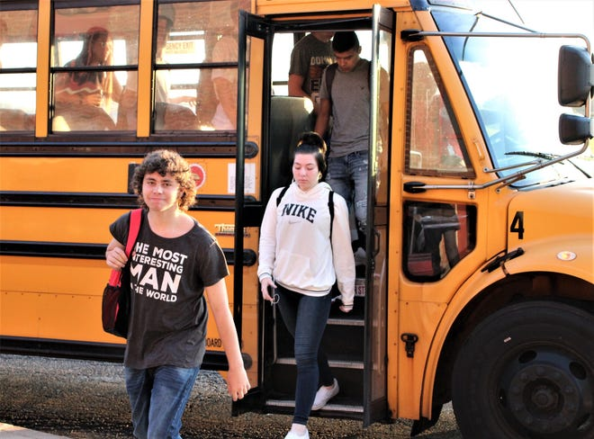 Students filed off buses and into the building for the first day of classes at Marion Harding High School in 2019.