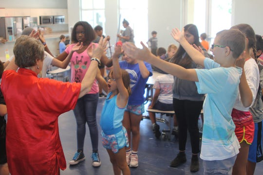 Marco Tai Chi instructor Jane Kiester puts campers and volunteers through a relaxing session during the diabetes camp.