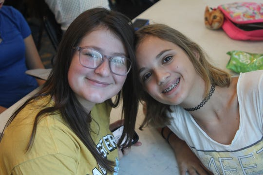 Nicole Sutton, left, and Madison Good credit the camp with turning them into friends for life.