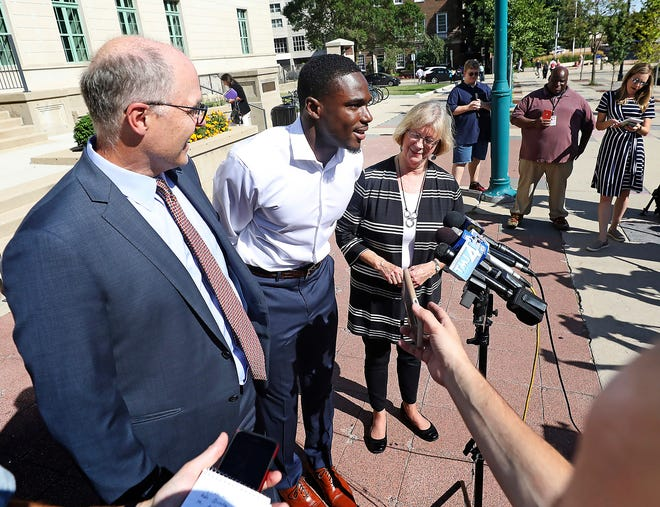 Quintez Cephus and his attorneys meet with members of the media after it was announced that he was readmitted to the University of Wisconsin. Later, UW's athletics department announced that Cephus was also welcomed back to the football team.