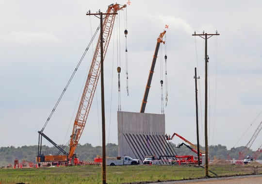Construction crews on Monday begin installing the first of some 400 precast panels that will make up the walls of Foxconn Technology Group's planned factory in Mount Pleasant.