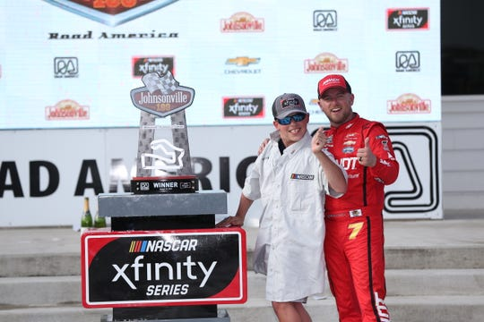 Dylan Bauerle of Germantown poses with winning driver Justin Allgaier and his trophy in victory lane at Road America after Allgaier won the 2018 NASCAR Xfinity Series Johnsonville 180. Bauerle served as an honorary official and spoke in the drivers meeting before the race.