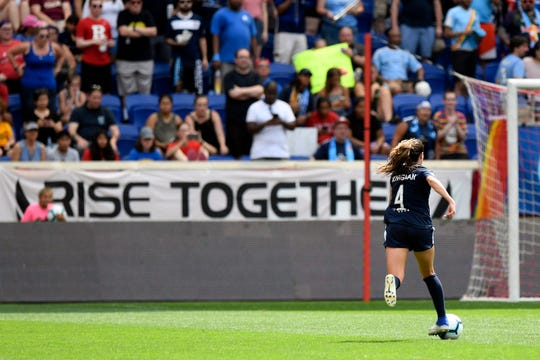 "Sky Blue forward Paige Monaghan, a Roxbury alumna, rushes towards the Reign FC goal and the Sky Blue fans, holding a ""Rise Together"" banner behind the goal. Sky Blue FC and Reign FC end in a tie, 1-1, at the Red Bull Arena on Sunday, August 18, 2019, in Harrison."