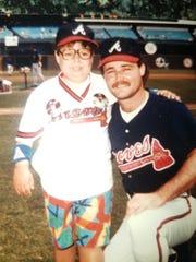 Steven Reeves with baseball hero Glenn Hubbard of the Atlanta Braves.