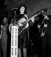Loretta Lynn performs during a Saturday night Grand Ole Opry show at the Ryman Auditorium on Dec. 10, 1966.