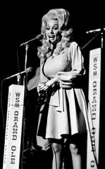 Dolly Parton performs during the Grand Ole Opry show on the stage of the Ryman Auditorium on July 21, 1973.